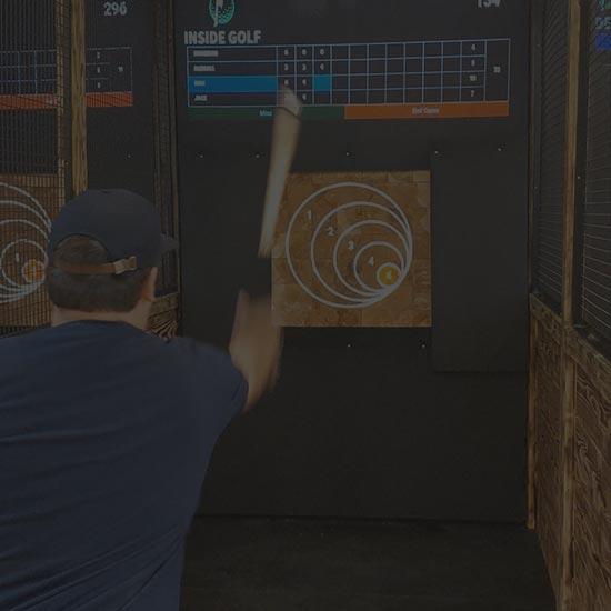 Man throwing an axe at a target