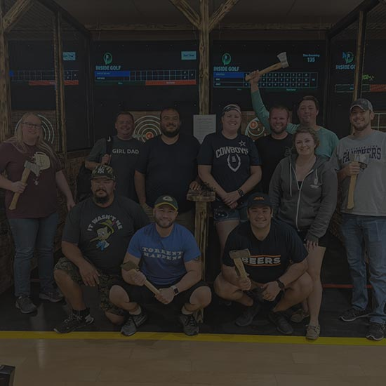 A large group of people having an axe throwing event in Ames