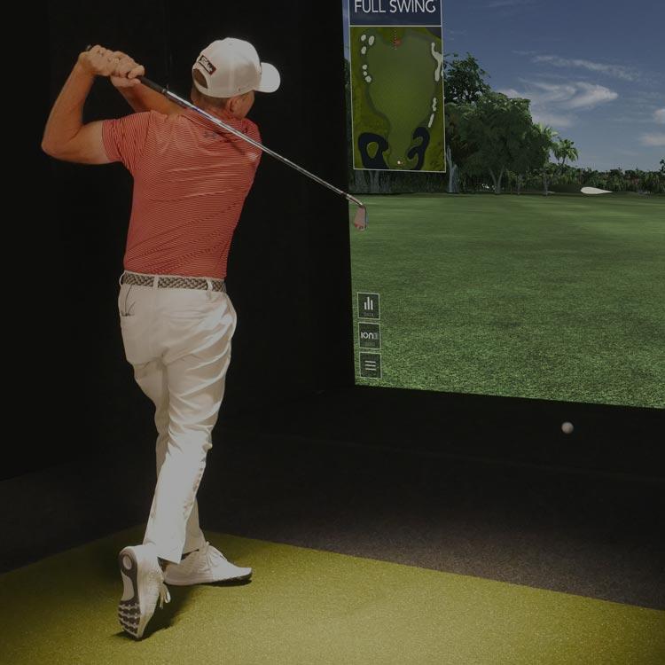 Man swinging golf club on Ames Golf Simulator