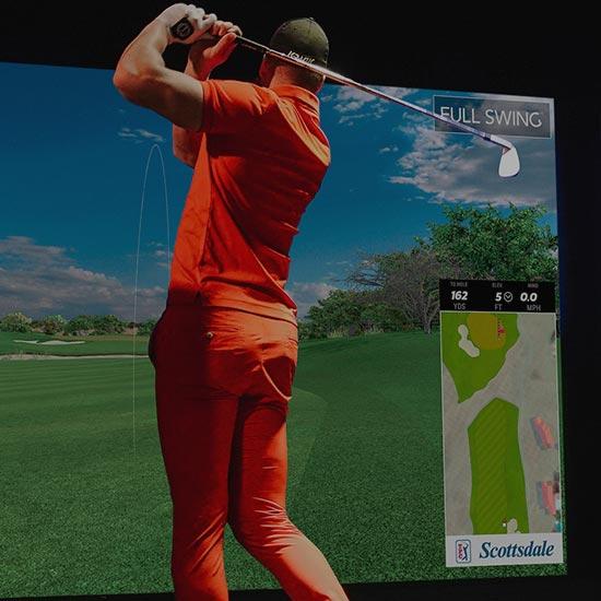 Man on golf simulator in Ames, Iowa