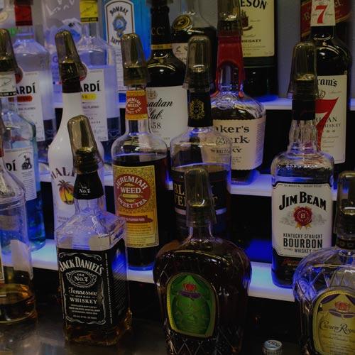 Bottles of liquor behind the bar at Inside Golf