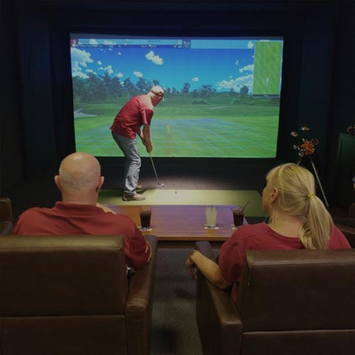 Friends get together for a round of golf at Inside Golf in Ames